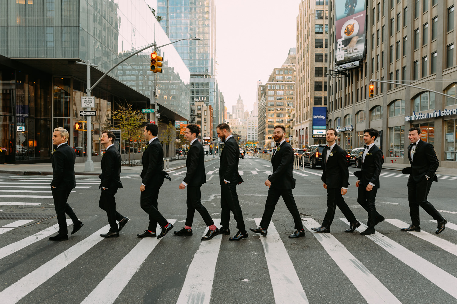 new york city winery wedding- groomsmen walking like the beatles