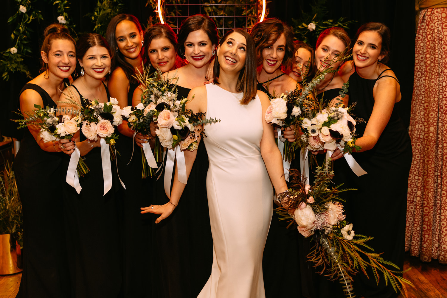 group portrait of a bride with bridesmaids