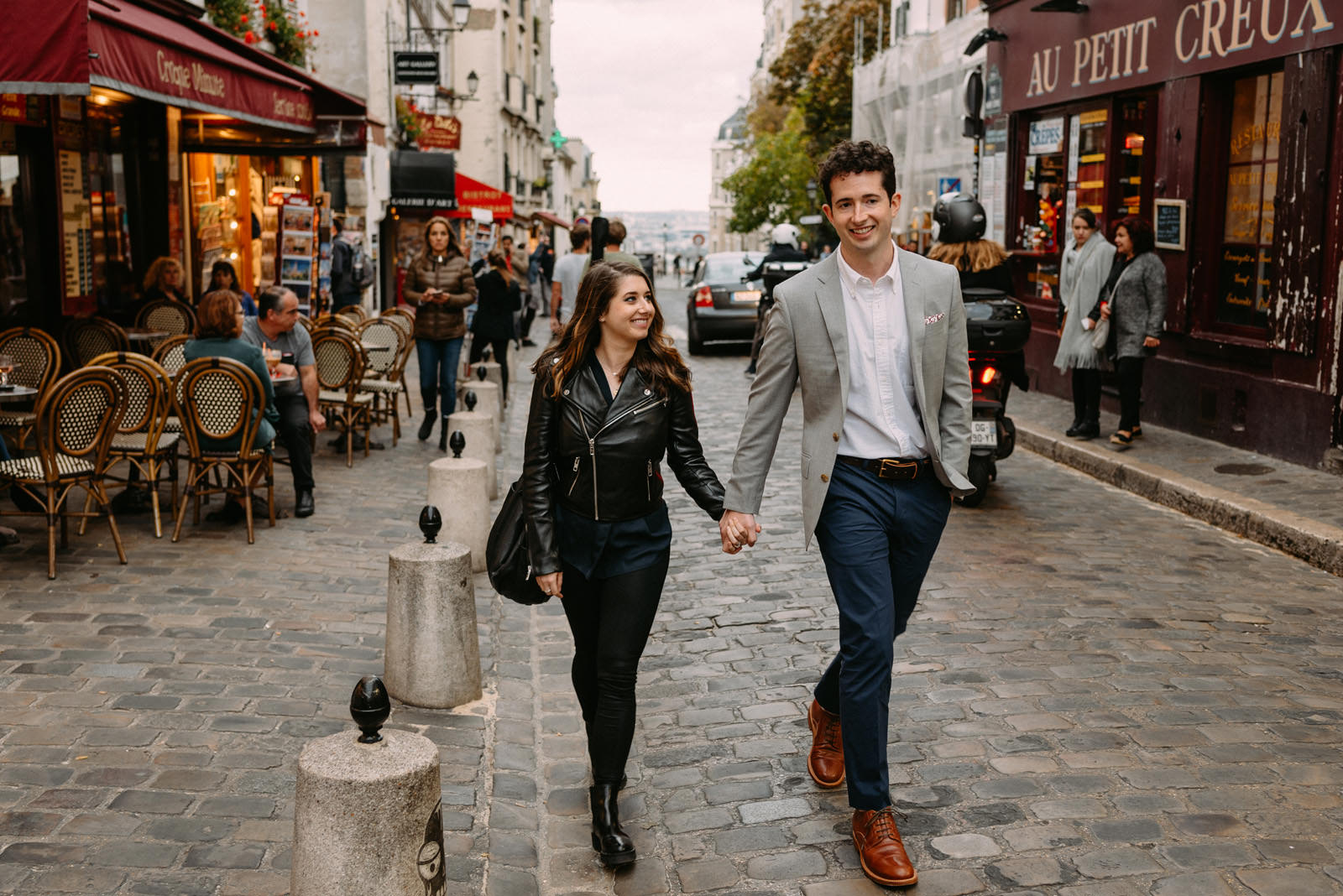 Couple just got engaged in Montmartre, Paris - photo by Luke Sezeck